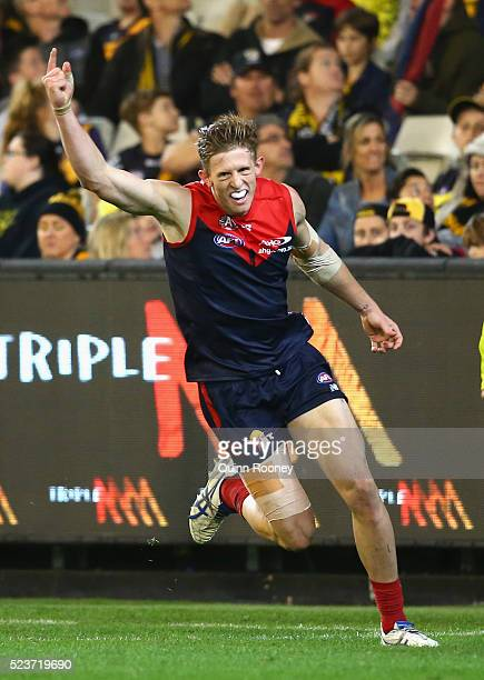 Sam Frost of the Demons celebrates after kicking a goal during the round five AFL match between the Melbourne Demons and the Richmond Tigers at...
