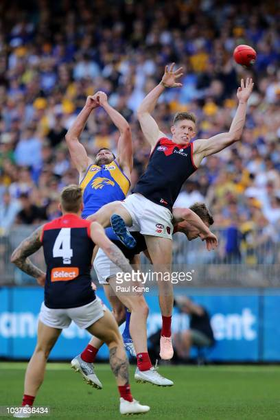 Sam Frost of the Demons contests for a mark against Jack Darling of the Eagles during the AFL Preliminary Final match between the West Coast Eagles...