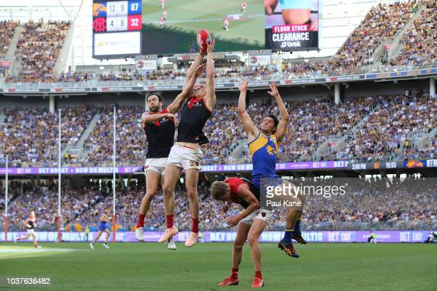 Sam Frost of the Demons contests for a mark against Tom Barrass of the Eagles during the AFL Preliminary Final match between the West Coast Eagles...