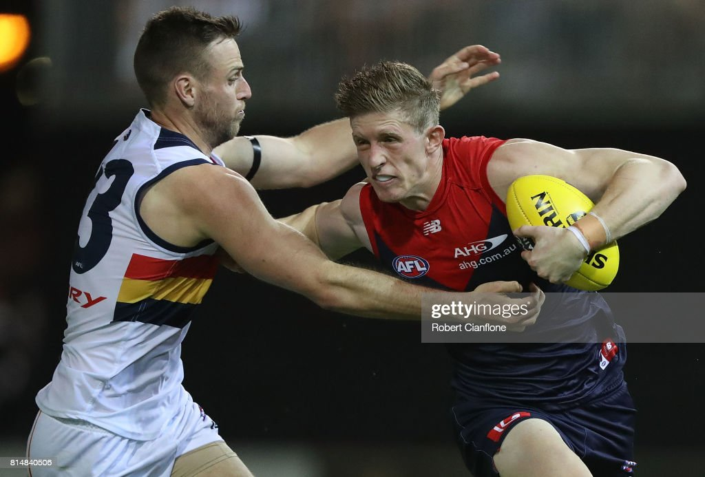 Sam Frost of the Demons is challenged by Brodie Smith of the Crows during the round 17 AFL match between the Melbourne Demons and the Adelaide Crows at TIO Stadium on July 15, 2017 in Darwin, Australia.