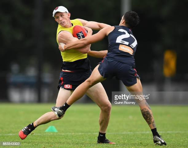 Sam Frost of the Demons is tackled by Harley Balic during a Melbourne Demons AFL training session at Gosch's Paddock on December 1 2017 in Melbourne...