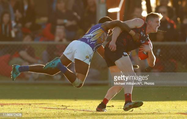 Sam Frost of the Demons is tackled by Liam Ryan of the Eagles during the 2019 AFL round 18 match between the Melbourne Demons and the West Coast...