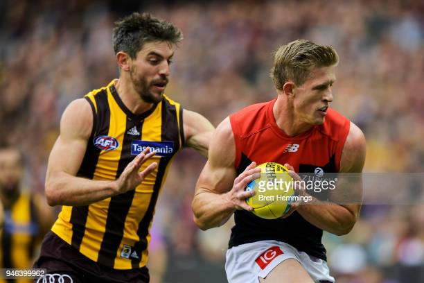 Sam Frost of the Demons is tackled by Ricky Henderson of the Hawks during the round four AFL match between the Hawthorn Hawks and the Melbourne...