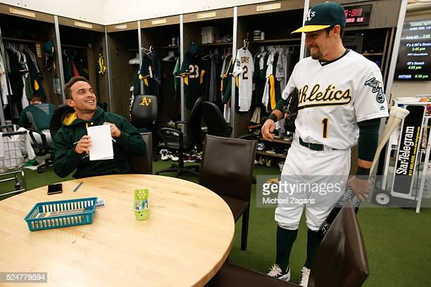 Sam Fuld and Billy Burns of the Oakland Athletics talk in the clubhouse prior to the game against the Los Angeles Angels of Anaheim at the Oakland...