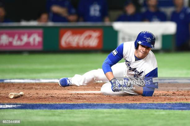 Sam Fuld of Israel falls in the seventh inning during the World Baseball Classic Pool E Game One between Cuba and Israel at Tokyo Dome on March 12...