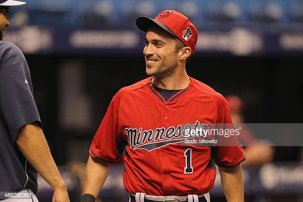 Sam Fuld of the Minnesota Twins chats with former teammates before the start of the game against the Tampa Bay Rays at Tropicana Field on April 23...
