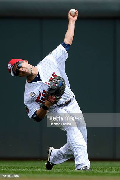 Sam Fuld of the Minnesota Twins makes a play in center field during the game against the New York Yankees on July 4 2014 at Target Field in...