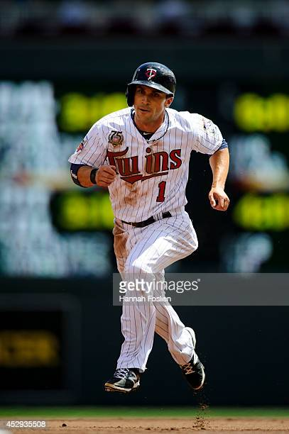 Sam Fuld of the Minnesota Twins runs the base path between second and third base during the game against the Chicago White Sox on July 27 2014 at...