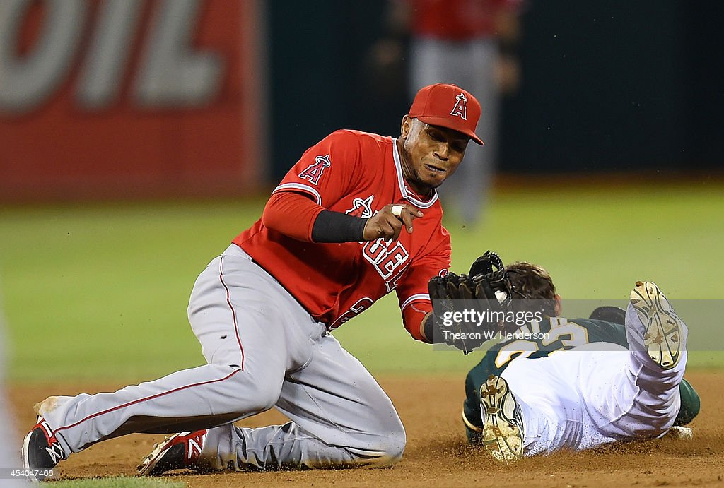 Sam Fuld #23 of the Oakland Athletics attempting to steal second base is tagged out by Erick Aybar #2 of the Los Angeles Angels of Anaheim in the bottom of the seventh inning at O.co Coliseum on August 23, 2014 in Oakland, California.