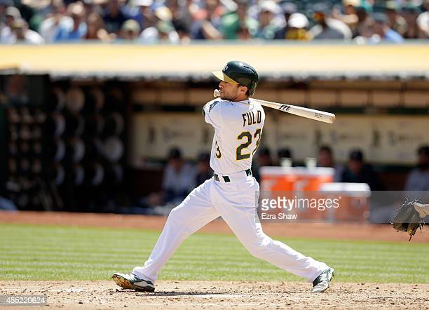Sam Fuld of the Oakland Athletics bats against the Seattle Mariners at Oco Coliseum on September 3 2014 in Oakland California