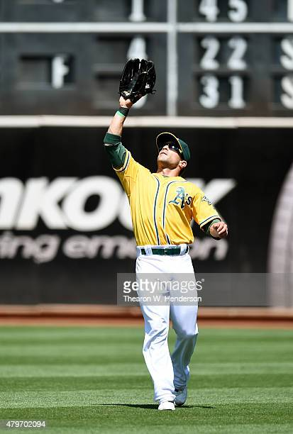 Sam Fuld of the Oakland Athletics catches a fly ball off the bat of Kyle Seager of the Seattle Mariners in the top of the six inning at Oco Coliseum...