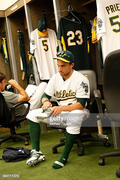 Sam Fuld of the Oakland Athletics gets dressed in the clubhouse prior to the game against the Kansas City Royals at Oco Coliseum on August 2 2014 in...