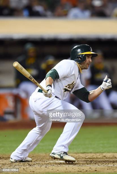 Sam Fuld of the Oakland Athletics hits an RBI single scoring Geovany Soto against the Texas Rangers in the bottom of the fifth inning at Oco Coliseum...