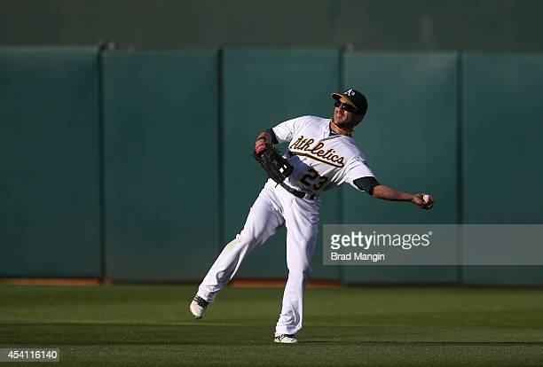 Sam Fuld of the Oakland Athletics makes a play in right field during the game against the Los Angeles Angels of Anaheim at Oco Coliseum on Sunday...