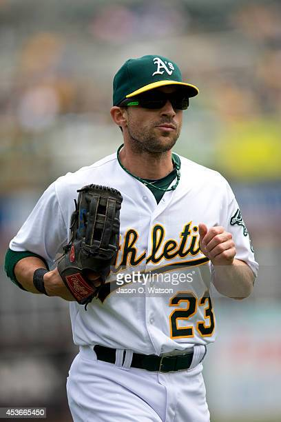 Sam Fuld of the Oakland Athletics returns to the dugout during the first inning against the Kansas City Royals at Oco Coliseum on August 3 2014 in...