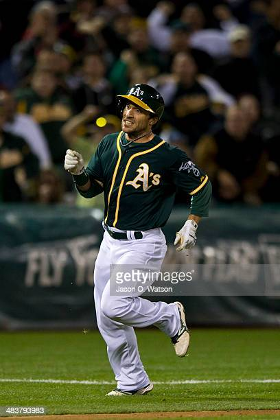 Sam Fuld of the Oakland Athletics rounds third base attempting to extend a triple against the Seattle Mariners during the fifth inning at Oco...