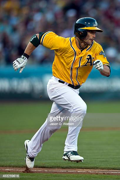 Sam Fuld of the Oakland Athletics runs to first base after an at bat against the Kansas City Royals during the fourth inning at Oco Coliseum on...