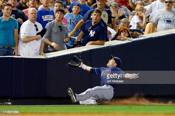 Sam Fuld of the Tampa Bay Rays attempts to make a catch on a fifthinning foul ball off the bat of Robinson Cano of the New York Yankees at Yankee...