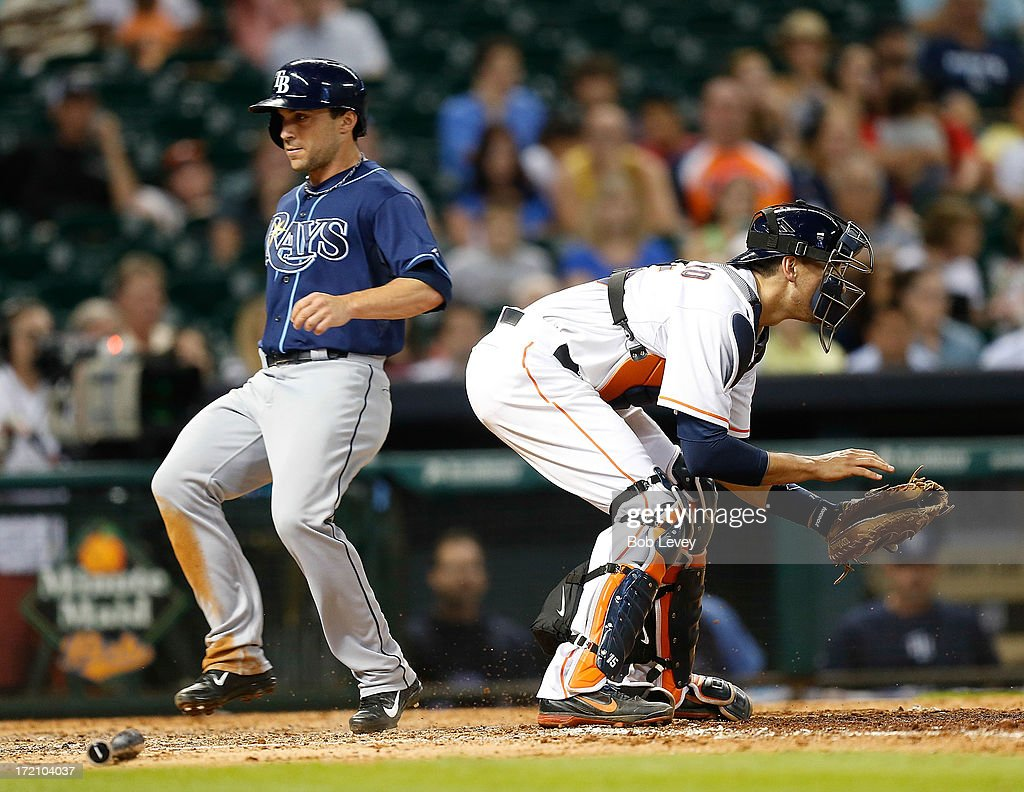 Sam Fuld #5 of the Tampa Bay Rays scores in front of Jason Castro #15 of the Houston Astros in the seventh inning at Minute Maid Park on July 1, 2013 in Houston, Texas.