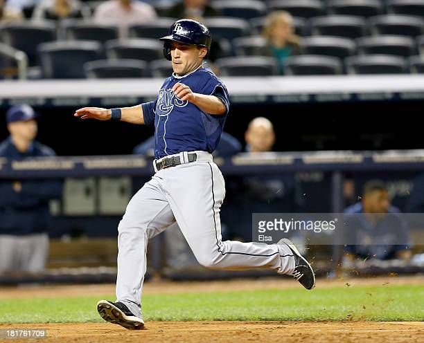 Sam Fuld of the Tampa Bay Rays scores in the ninth inning against the New York Yankees on September 24 2013 at Yankee Stadium in the Bronx borough of...