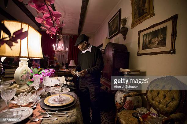 Sam Fuller a waiter who has been a Villa Carlotta resident for nearly 40 years shows off his party table setting he meticulously decorated and his...