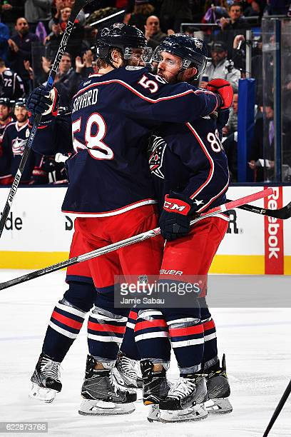Sam Gagne of the Columbus Blue Jackets celebrates his first period goal with teammate David Savard of the Columbus Blue Jackets during a game against...