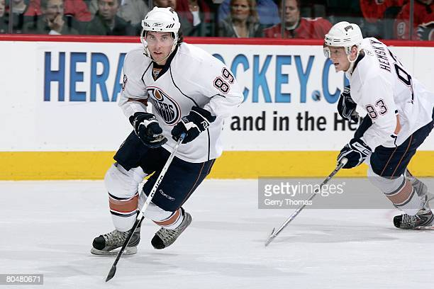 Sam Gagner and Ales Hemsky of the Edmonton Oilers skate against the Calgary Flames on March 29 2008 at Pengrowth Saddledome in Calgary Alberta Canada...