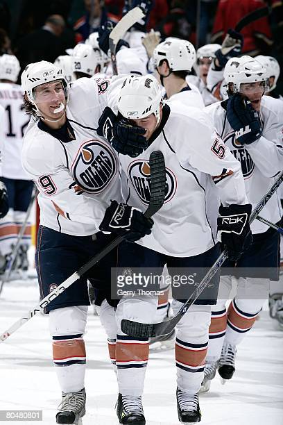 Sam Gagner and Kyle Brodziak of the Edmonton Oilers celebrate a win against the Calgary Flames on March 29 2008 at Pengrowth Saddledome in Calgary...