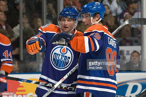 Sam Gagner and Lubomir Visnovsky of the Edmonton Oilers discuss a play during a game against the Toronto Maple Leafs at Rexall Place November 13 2008...