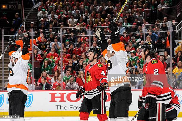 Sam Gagner and Ryan White of the Philadelphia Flyers react next to Niklas Hjalmarsson and Duncan Keith of the Chicago Blackhawks after the Flyers...
