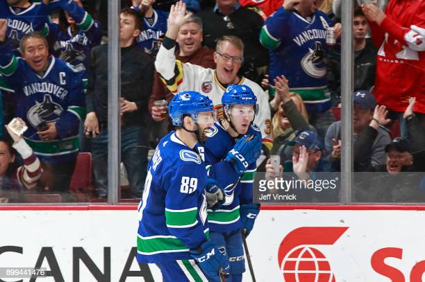 Sam Gagner celebrates with Brock Boeser of the Vancouver Canucks after scoring during their NHL game against the Chicago Blackhawks at Rogers Arena...
