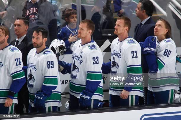 Sam Gagner Henrik Sedin Daniel Sedin and Markus Granlund of the Vancouver Canucks stand for the national anthem of the San Jose Sharks at SAP Center...