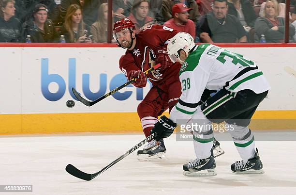 Sam Gagner of the Arizona Coyotes passes the puck past Vernon Fiddler of the Dallas Stars during the second period at Gila River Arena on November 11...