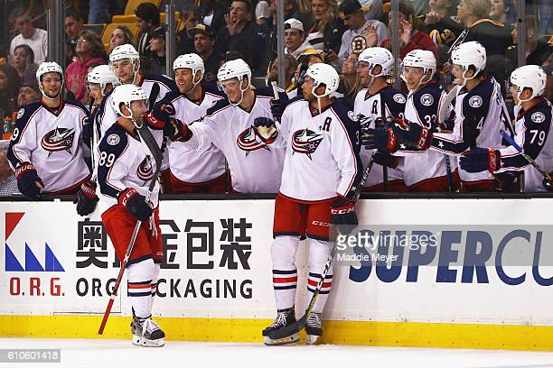 Sam Gagner of the Columbus Blue Jackets celebrates with teammates after scoring the game winning goal against the Boston Bruins during a shootout in...