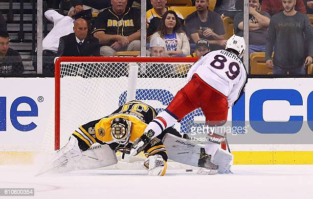Sam Gagner of the Columbus Blue Jackets scores the game winning goal against Zane McIntire of the Boston Bruins during a shootout in the preseason...
