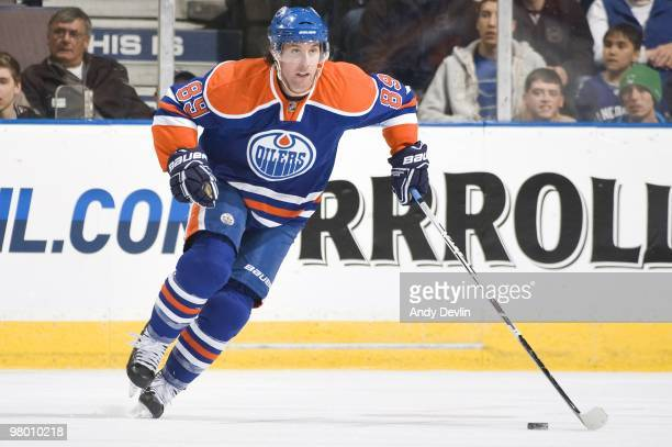 Sam Gagner of the Edmonton Oilers carries the puck against the Vancouver Canucks at Rexall Place on March 23, 2010 in Edmonton, Alberta, Canada. The...