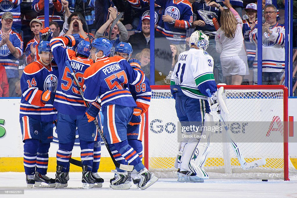 Sam Gagner #89 of the Edmonton Oilers celebrates after scoring a goal against Eddie Lack #31 of the Vancouver Canucks during a preseason NHL game at Rexall Place on September 21, 2013 in Edmonton, Alberta, Canada.