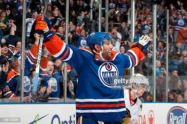 Sam Gagner of the Edmonton Oilers celebrates one of his all-time franchise tying eight points in a single game against the Chicago Blackhawks at...