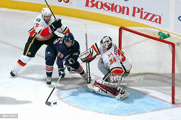 Sam Gagner of the Edmonton Oilers cuts towards Miikka Kiprusoff of the Calgary Flames for a shot at Rexall Place on April 1 2008 in Edmonton Alberta...