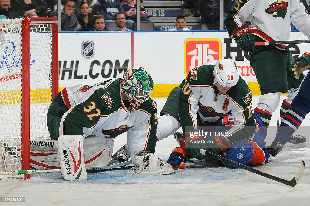 Sam Gagner #89 of the Edmonton Oilers gets taken down by Ryan Suter #20 of the Minnesota Wild on April 16, 2013 at Rexall Place in Edmonton, Alberta, Canada.