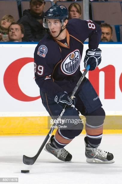 Sam Gagner of the Edmonton Oilers looks up ice with the puck during a preseason game against the Vancouver Canucks on September 22 2008 at Rexall...