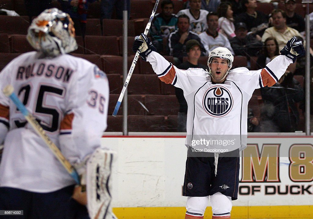Sam Gagner #89 of the Edmonton Oilers raises his arms to teammate goaltender Dwayne Roloson #35 in celebration after they defeated the Anaheim Ducks 5-3 in their NHL game at Honda Center on March 27, 2009 in Anaheim, California.