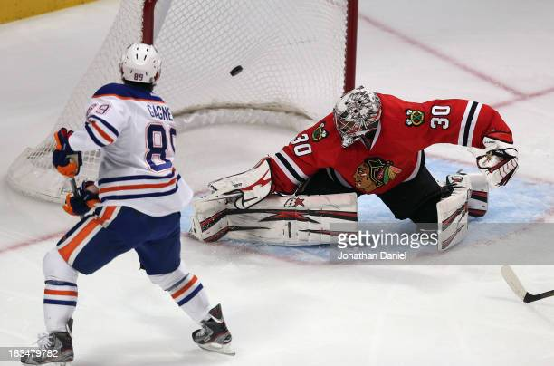 Sam Gagner of the Edmonton Oilers scores a 1st period goal against Ray Emery of the Chicago Blackhawks at the United Center on March 10 2013 in...