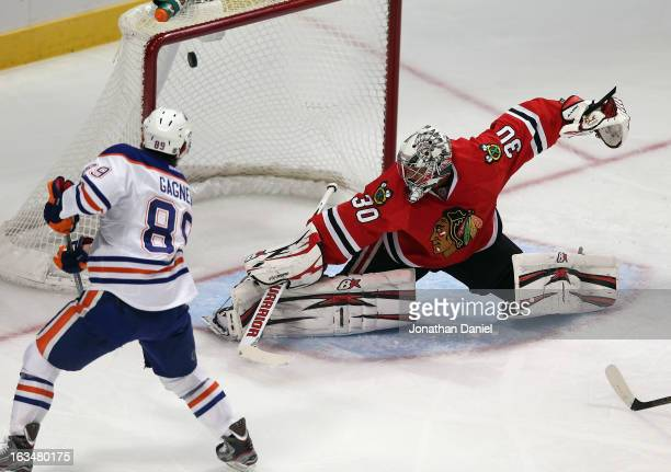 Sam Gagner of the Edmonton Oilers scores a 1st period goal against Ray Emery of the Chicago Blackhawks at the United Center on March 10, 2013 in...