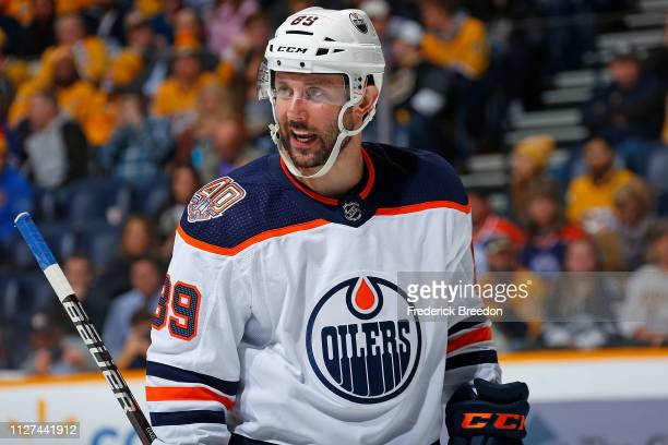Sam Gagner of the Edmonton Oilers speaks to a teammate during the second period of a game against the Nashville Predators at Bridgestone Arena on...