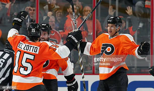 Sam Gagner of the Philadelphia Flyers celebrates his secondperiod powerplay goal against the Chicago Blackhawks with teammates Michael Del Zotto and...