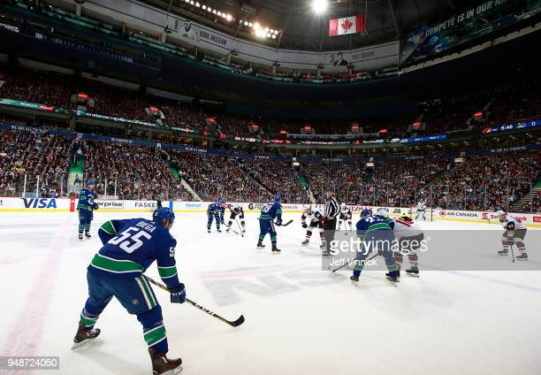Sam Gagner of the Vancouver Canucks and Dylan Strome of the Arizona Coyotes faceoff during their NHL game at Rogers Arena April 5 2018 in Vancouver...