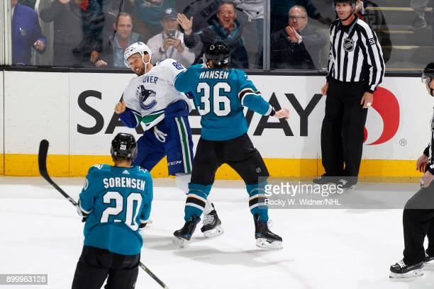 Sam Gagner of the Vancouver Canucks and Jannik Hansen of the San Jose Sharks get into an altercation at SAP Center on December 21 2017 in San Jose...