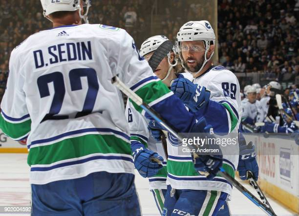 Sam Gagner of the Vancouver Canucks celebrates a goal against the Toronto Maple Leafs during an NHL game at the Air Canada Centre on January 6 2018...
