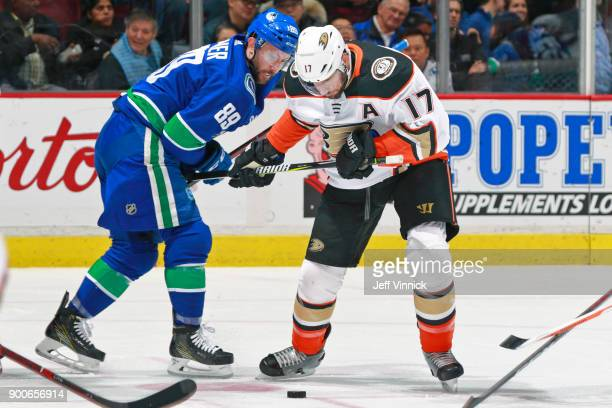 Sam Gagner of the Vancouver Canucks checks Ryan Kesler of the Anaheim Ducks during their NHL game at Rogers Arena January 2 2018 in Vancouver British...